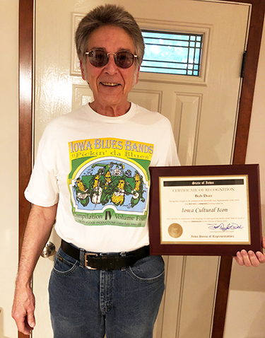 Bob Dorr with plaque from Iowa House honoring him as an Iowa Cultural Icon
